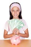 Bambina con con con le fatture del dollaro Fotografia Stock