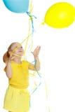 Bambina con gli aerostati Immagini Stock Libere da Diritti
