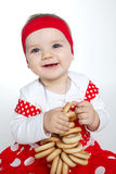 Bambina con gli pane-anelli fotografie stock