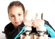 Bambina con i pattini di rullo fotografia stock libera da diritti