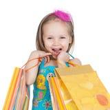 Bambina con i sacchetti di acquisto Fotografie Stock