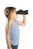 Bambina con il binocolo Fotografia Stock