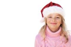 Bambina con il cappello della Santa su priorità bassa bianca Fotografia Stock Libera da Diritti