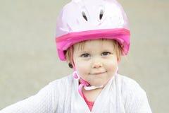 Bambina con il casco Immagini Stock Libere da Diritti