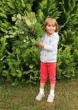 Bambina con il fiore Immagini Stock Libere da Diritti