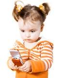Bambina con il fon mobile Fotografie Stock Libere da Diritti