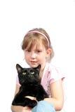 Bambina con il gatto nero Fotografie Stock Libere da Diritti