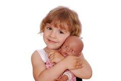 Bambina con il giocattolo della bamboletta Fotografia Stock Libera da Diritti