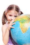 Bambina con il globo Immagini Stock
