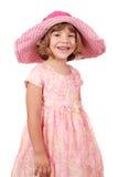 Bambina con il grande cappello su bianco Immagine Stock