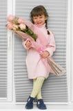 Bambina con il mazzo Fotografie Stock Libere da Diritti