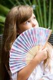Bambina con il ventilatore Fotografia Stock