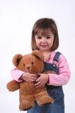 Bambina con l'orso dell'orsacchiotto Immagini Stock