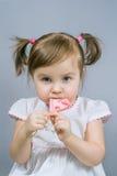 Bambina con la lecca-lecca Fotografie Stock