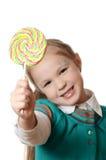 Bambina con la lecca-lecca su bianco Fotografia Stock Libera da Diritti