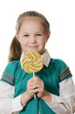 Bambina con la lecca-lecca su bianco Fotografia Stock