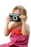 Bambina con la retro macchina fotografica Fotografia Stock