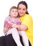 Bambina con la sua madre grassa Immagini Stock Libere da Diritti