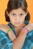 Bambina con le braccia attraversate Immagine Stock