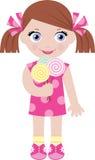 Bambina con le caramelle di zucchero Fotografia Stock