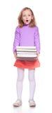 Bambina con molti libri fotografie stock