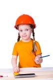 Bambina con un casco della costruzione Immagine Stock