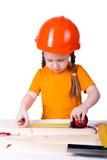 Bambina con un casco della costruzione Fotografie Stock