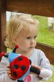 Bambina con un giocattolo Fotografia Stock