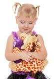 Bambina con un giocattolo molle Fotografia Stock Libera da Diritti
