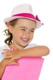 Bambina con un libro Immagini Stock