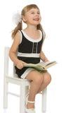 Bambina con un libro Fotografia Stock
