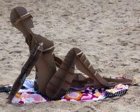 Bambina della spiaggia del cartone Immagine Stock