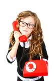 Bambina di affari con un telefono rosso su un fondo bianco Immagini Stock