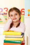 Bambina con i libri Immagine Stock