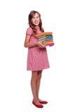 Bambina di smiley con i libri Immagini Stock
