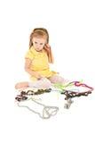 Bambina Displeased con seduta del gioiello fotografia stock libera da diritti