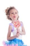 Bambina divertente con la lecca-lecca fotografia stock