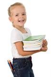 Bambina felice con i libri di banco Immagini Stock