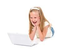 Bambina felice con il computer portatile Fotografia Stock