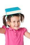 Bambina felice con il libro Immagine Stock Libera da Diritti