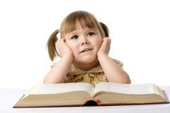 Bambina felice con il libro, di nuovo al banco Fotografie Stock Libere da Diritti