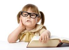 Bambina felice con il libro, di nuovo al banco Fotografie Stock