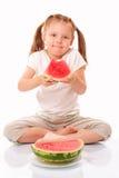 Bambina felice con l'anguria immagine stock