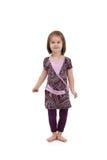 Bambina felice in vestito grazioso Fotografia Stock