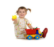 Bambina graziosa ed i suoi giocattoli Fotografie Stock Libere da Diritti
