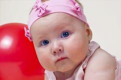 Bambina graziosa, su una priorità bassa bianca Fotografia Stock Libera da Diritti