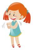 Bambina in mani d'applauso del vestito blu Fotografia Stock Libera da Diritti