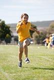 Bambina nella corsa di sport fotografia stock