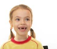 Bambina senza i denti. fotografie stock