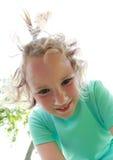 Bambina sorridente Immagini Stock